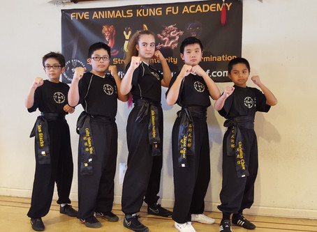 Congratulations to Five Animals Kung Fu Academy's first Black Belt graduates!