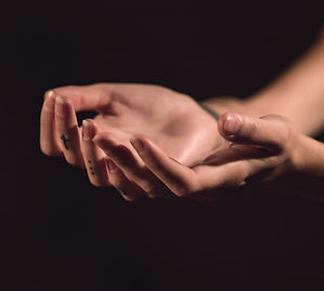 The hands of a volunteer extend to offer help.