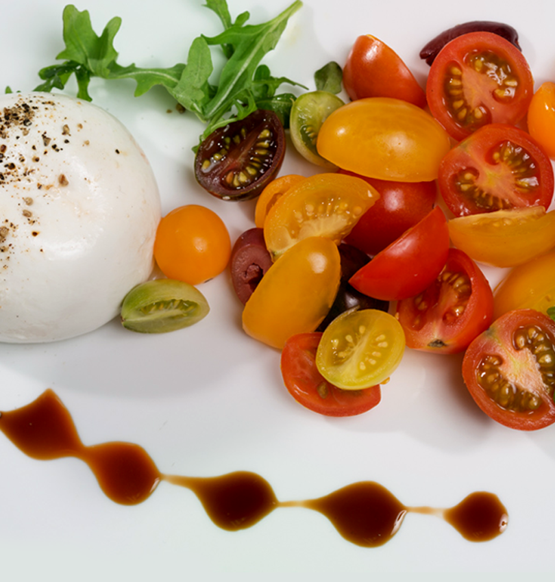 burrata and heirloom tomatoes.png