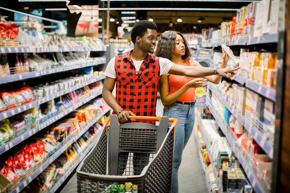 Black couple shopping in store