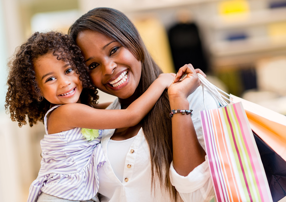 Black women with her daughter shopping