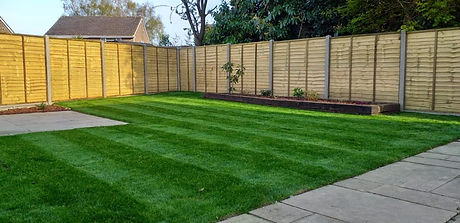 New luxurious turf has been laid as part of a landscaping project where a new fence was also installed.  A new patio was laid and there was raised reclaimed oak sleeper flower beds.  The fence was installed using concrete posts and gravelboards including a hedgehog highway.
