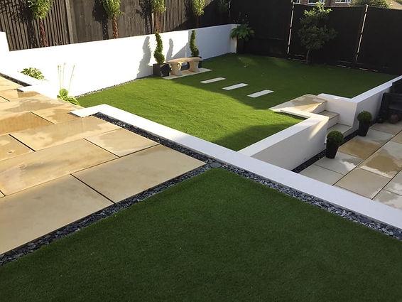 Garden design, modern, terraced, retaining walls, with astroturf, false grass, fake grass, porcelain patio, paving, fencing, digging and luxury modern garden.