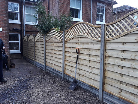 This is a top quality, top of the range fencing, fence, with a wave pattern trellis on the top.  Installed using concrete gravel boards to stop the fence from rotting.  Concrete fence posts to make the landscaped garden look much improved.