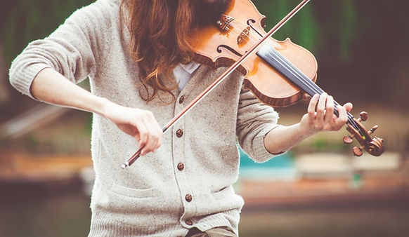 woman-in-gray-cardigan-playing-a-violin-