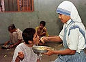 nun helping a person.jpg