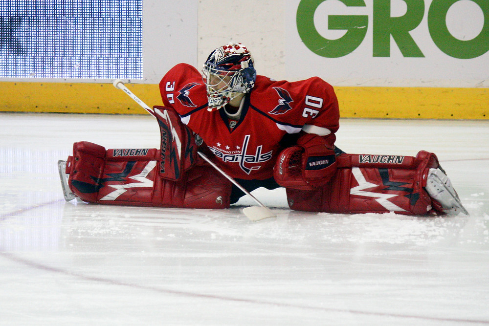 Michal Neuvirth stretches before the Washington Capitals' game against the New York Islanders.