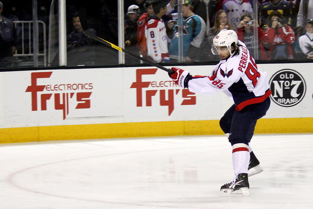 Matthieu Perreault takes a shot during warmups before the Washington Capitals game against the Sharks in San Jose, Calif.
