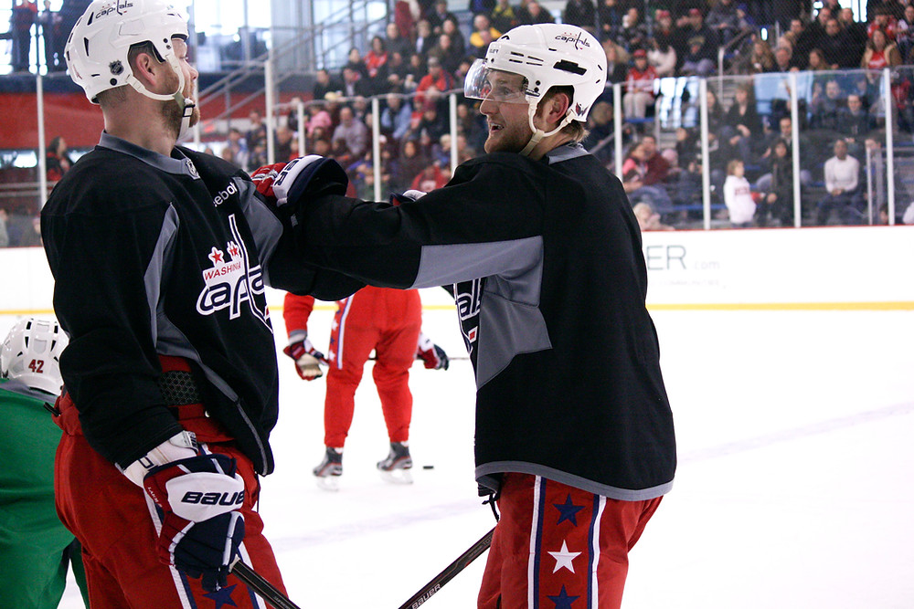 Karl Alzner gets fighting tips from Washington Capitals tough guy John Erskine the day after his fight.