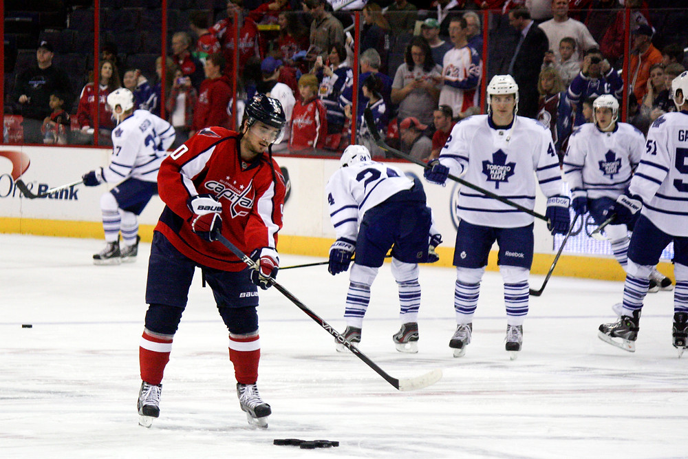 Marcus Johansson passes pucks during warmups before the Washington Capitals played host to the Toronto Maple Leafs.