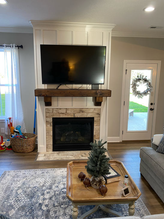 Reclaimed wood beam mantel with corbels