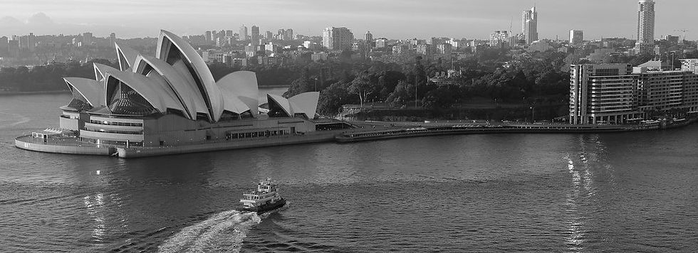 Image of the Sydney Harbour, with the Opera House and a ferry visible