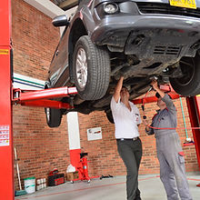 auto mechanics repairing suspension