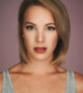 Susanne Burgess Headshot Pink.JPG