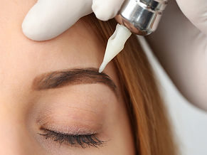 Megan at Bella Ink Permanent Makeup applies semi peranent ombre eyebrows on her client