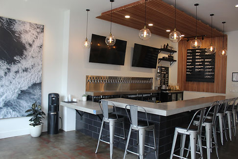 Custom Countertop for Saint ArcerBrewing. Work done by DC Concrete Countertops made with Glass Fiber-Reinforced Concrete