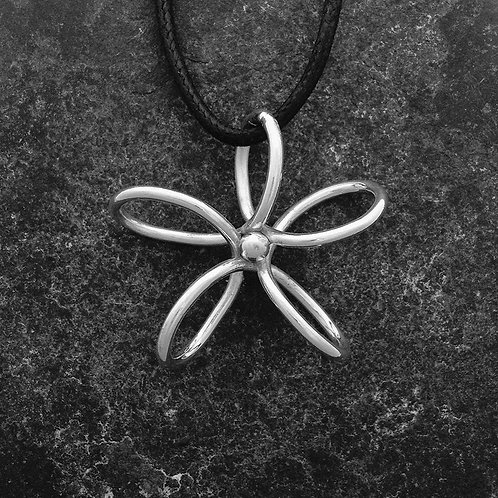 Flower pendant in fine silver on a cord.