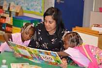 2 Dr. Nivea Torres reads with children a
