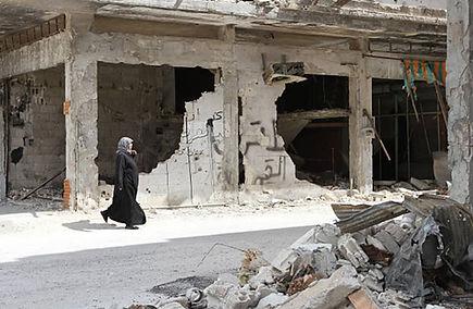 womancrossing bombed street.JPG