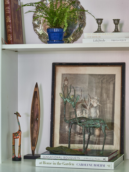 Detail shot of clients bookshelves show a mix of new accessories and family momentos