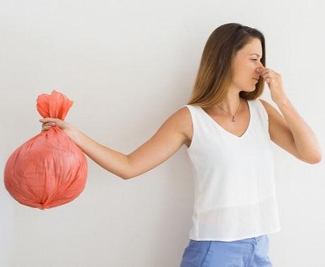displeased-woman-holding-garbage-bag_1262-4979_edited.jpg