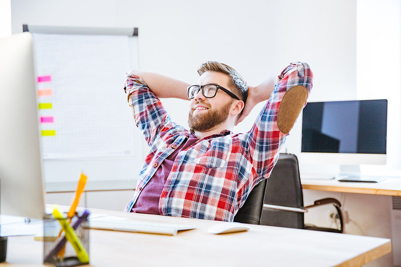 happy-man-sitting-with-hands-behind-head-and-relax-P4D34Z6.jpg