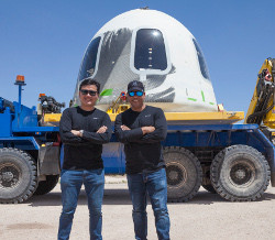mu Space CEO and founder James Yenbamroong (left) in front of the crew capsule which carried the experiments into space. Photo taken by Blue Origin