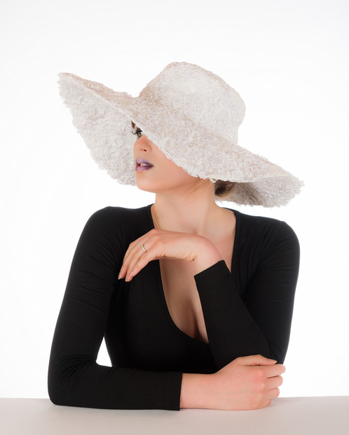 A wired brim white floppy hat embellished in exquisite bridal lace with  sparkling sequin and pearl beads. 5f8717074b6