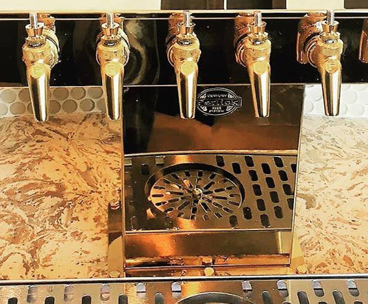 Beautiful golden beer tap installed