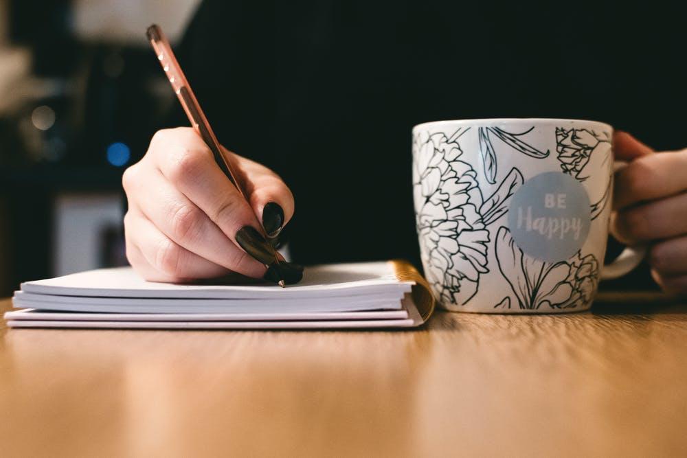 a writer with a mug