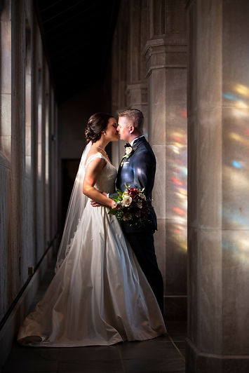 A romantic newlywed couple in a cathedral