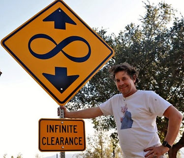 Scott Froschaugen with Infinite Clearance Street Sign.jpg
