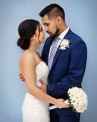 bride-and-groom-standing-next-to-each-ot