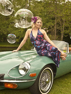 e-type car and girls 1970s