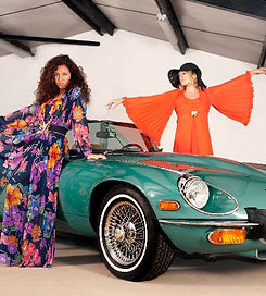 1970s girls with E-type car