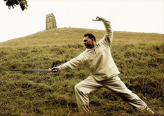 Rob with sword on Glastonbury Tor as part of a stop motion animation film