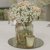 • 8x Glass vases filled with floral centrepieces • 8x Mirror base in silver gold, rose gold or log slice • 2x Candle votives with LED Candles for each table • 1x Top table / ceremony table artificial floral spray