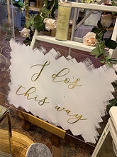 """""""I Do's This Way"""" Acrylic Sign With White Painted Back and Gold Lettering"""