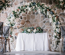 7ft Artificial Floral Wedding Arch. Filled with a variety of white flowers and greenery to create a stunning full backdrop. We can also add in your accent colours to match your theme.