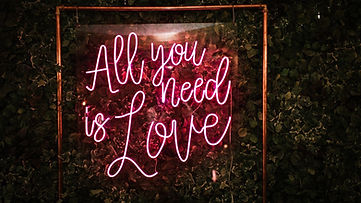 All You Need Is Love in Pink LED Neon