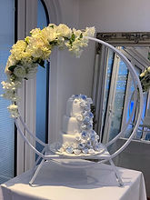 White Double Hoop Cake Stand With Artificial Flowers and Foliage