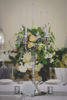 • 8x Large candelabras in silver or gold with florals • 8x Mirror base in silver or gold • 4x Candle votives with LED candles for each table • 1x Top table / ceremony table artificial floral spray • * Upgrade to a full length floral runner for the top table for £50.00 *