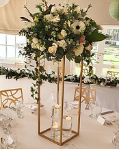 • 8x Large gold metal stands with very large floral centrepieces in ivory, foliage and any accent colour • 1x Ceremony table artificial floral spray including arrangements in ivory, foliage and any accent colour • 1x Top Table large full length floral runner in ivory, foliage and any accent colour