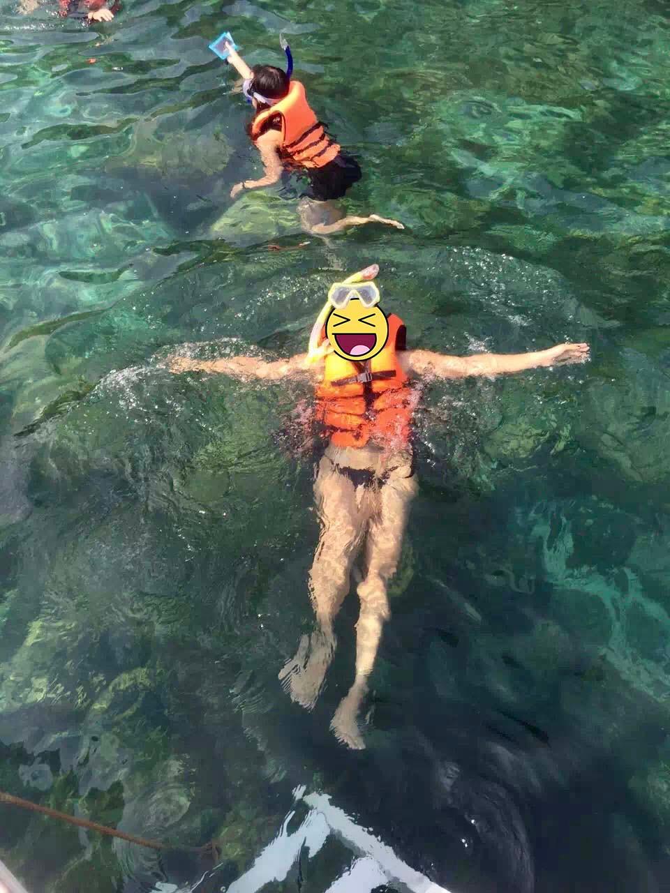 wife snorkeling
