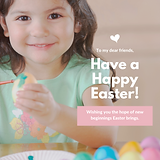 A young girl smiling because it is easter time