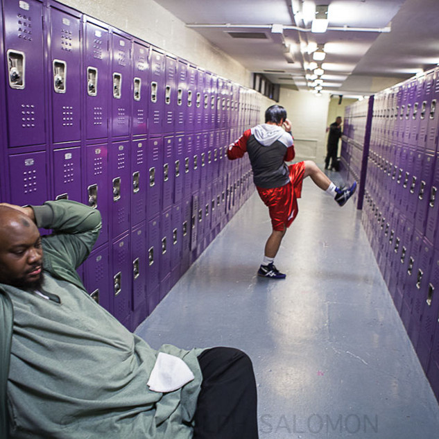 Boxer Warms Up in High School Locker Roo