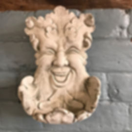 Smiling Green Man with Dish