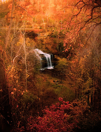 photograph of a distant waterfall in the fall woods