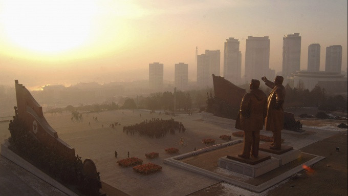 Sixty-foot-tall statues of North Korea's founder, Kim Il-sung, and former leader Kim Jong-il stand before the Korean Revolution Museum in Pyongyang. The statue of Kim Il-sung was unveiled in 1972 and Kim Jong-il's was erected after his death in 2011.