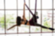 Young woman practices aerial different i